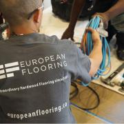 a professional flooring installer installing hardwood flooring